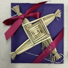 Laura Travis, A Brigid Cross, Traditional Irish Brigid Crosses are wrapped in harvest and holiday color ready for giving.