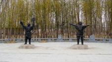 These two statues show the situation that soldiers are taking exercises to improve their abilities to protect the city in one hundred years ago. The weapons are spears and shields.
