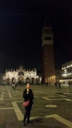 Me with my gelato in St. Mark's Square with the basilica and campanile in the background