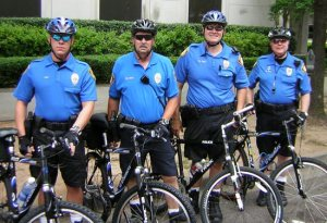 Four campus policemen on bikes