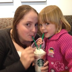 Photograph of Sarah sharing a Starbucks Frappé with her daughter