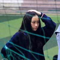 Vi Tran Yen standing behind a net