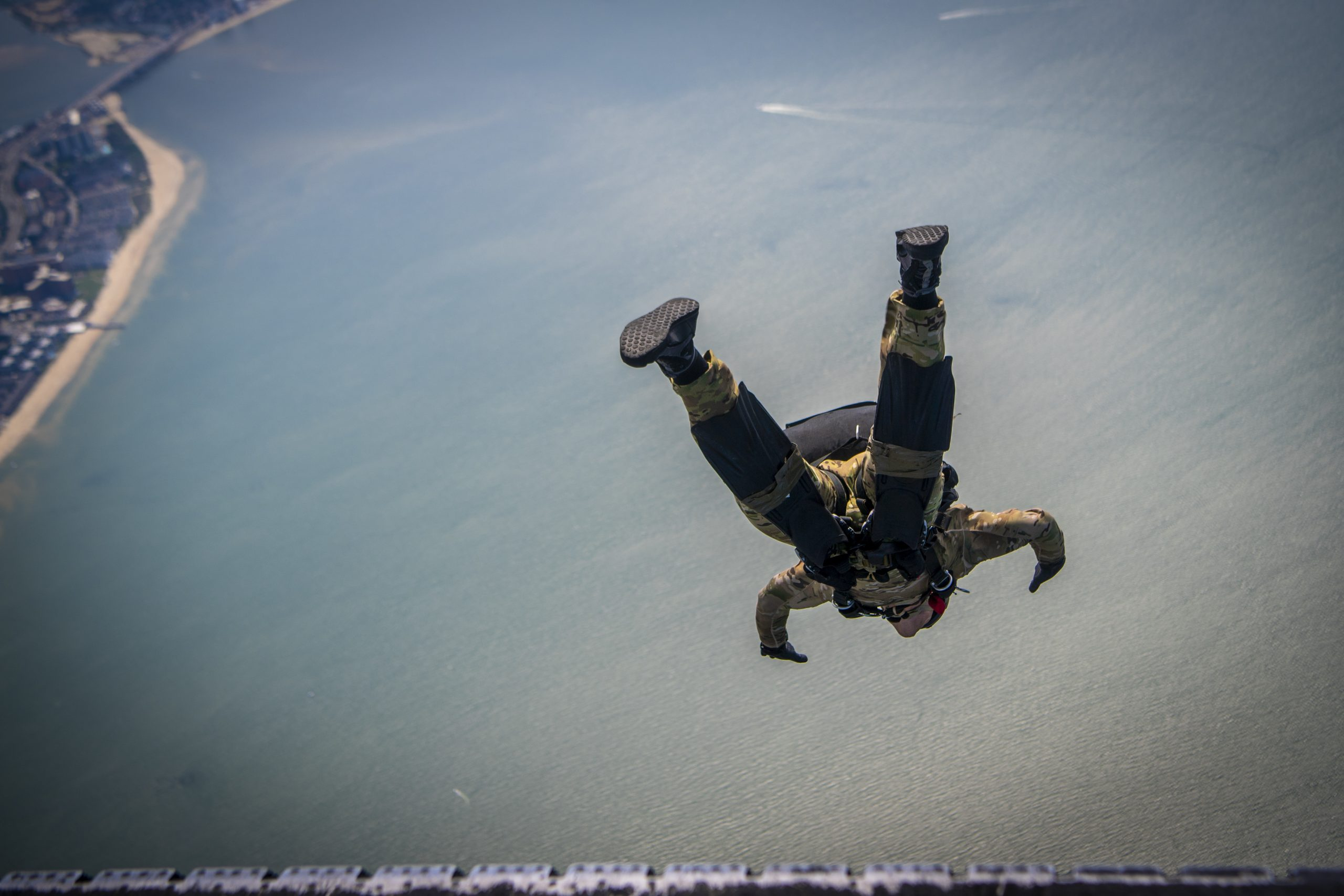 VIRGINIA BEACH, Va. (July 7, 2020) An East coast-based Navy SEAL conducts a military freefall jump from a C-2 Greyhound from the Rawhides of Fleet Logistics Support Squadron 40 during training above Chesapeake Bay. Naval Special Warfare Command is committed to its Sailors and the deliberate assessment and development of their tactical excellence, ethics, and leadership as the nation's premiere maritime special operations force supporting the National Defense Strategy. It is the maritime component of United States Special Operation Command, and its mission is to provide maritime special operations forces to conduct full-spectrum operations, unilaterally or with partners, to support national objectives. (U.S. Navy photo by Mass Communication Specialist First Class Scott Fenaroli)
