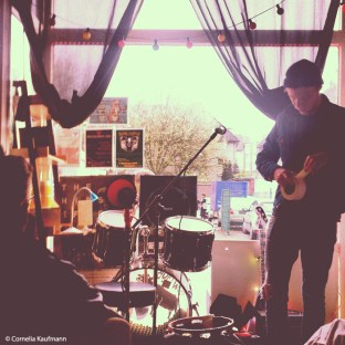 Band setting up in the window of Cow Club's Wohnzimmer in Solingen. Copyright Cornelia Kaufmann
