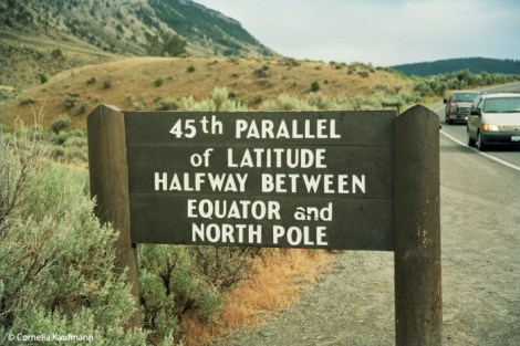 Sign at the 45th parallel in Yellowstone NP, Montana. Copyright Cornelia Kaufmann