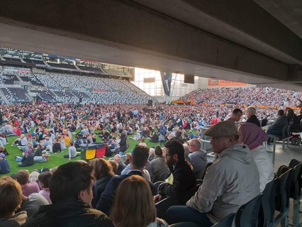 Dunedin's stadium is packed tonight for thecity's vigil for the Christchurch terror attacks. It's estimated 18,000 people are there. The north stand of the stadium has opened up to accommodate the crowds.