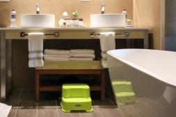 Bathrooms with soaker tub, dual vanity sinks, modern design