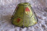 green glass and wire lampshade