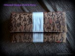 clutch purse, oriental style, satin, embroidered design, brown and white