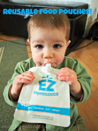 baby using a reusable food pouch