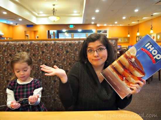mother and daughter looking confused at the different IHop menus
