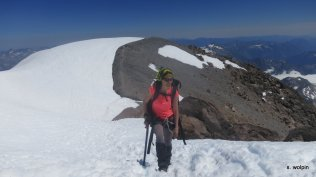 Edith takes on the last few steps to the summit
