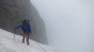 After some study we skirted around them in the fog and worked our way up
