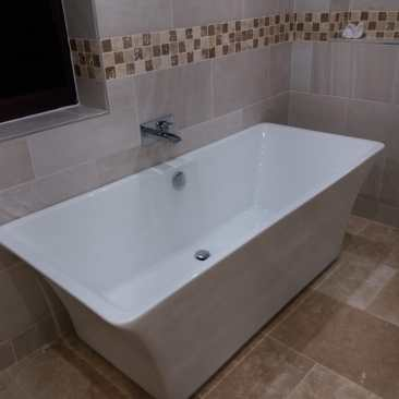 Freestanding Bath with Waterfall Mixer Tap