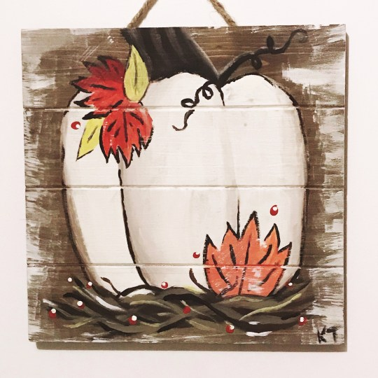 A white pumpkin painted on a pallet at a recent paint night.