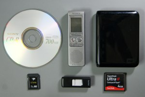 a CD-R, digital voice recorder, external hard drive, mini SD card, flash drive, and SD card