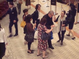 Artistic Director Reid Anderson with visitors in the foyer of the Bunka Kaikan Theatre