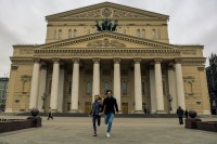 Friedemann Vogel and Alicia Amatriain in front of the Bolshoi Theatre