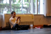 Jason Reilly taking a break after rehearsal and staying in touch with the rest of the world
