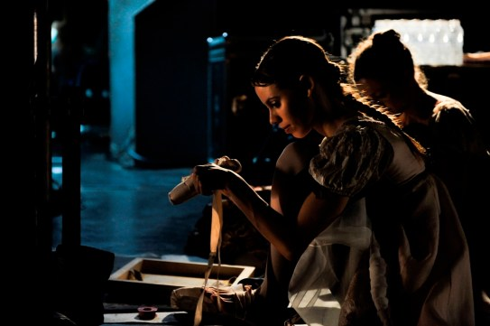 Elisa Badenes prepares her pointe shoes before a stage rehearsal.