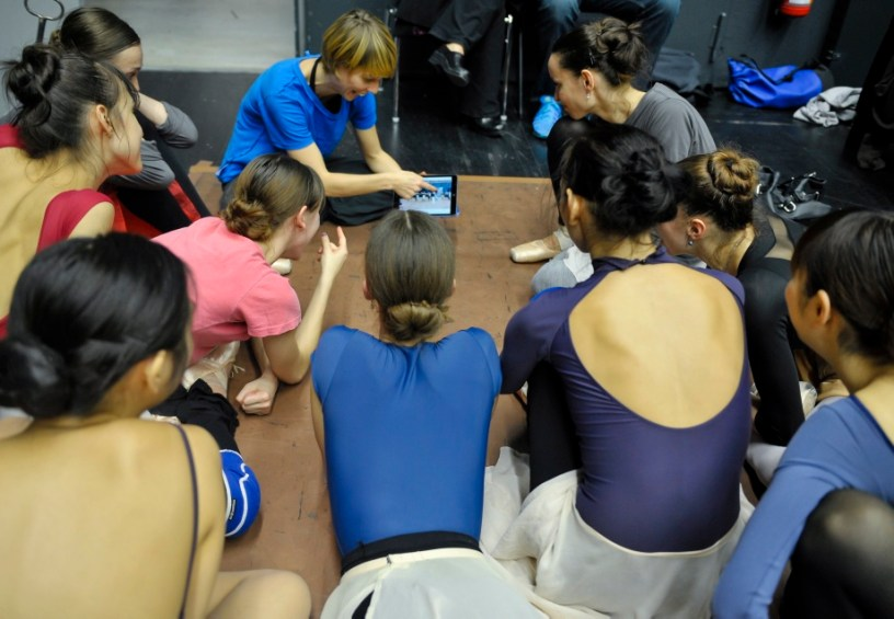 Acacia Schachte reviewing the video of the rehearsal with the dancers