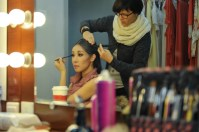 Hyo-Jung Kang doing her make-up before the performance and Jenny Drechsler-Vogel dressing her hair