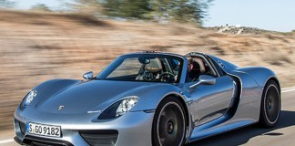 Porsche 918 Spyder Robb Report Car of 2015: A silver 918 Spyder, seen here from the left front-view, cruisin' on down the road. Source: PCNA