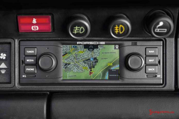Porsche Classic releases navigation radio: Porsche Classic's new navigation radio is seen here in the dash, in a tight shot on it. Credit: Porsche AG