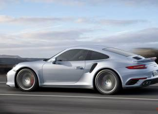 Porsche AG 2015 worldwide record year: Silver 2017 991-2 Turbo coupe left side on road. Credit: Porsche AG