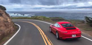 Porsche reports record April 2016 USA sales: 2017 red Carrera right-rear on coastal highway. Credit: Porsche AG