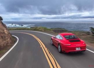 Porsche reports record April 2016 USA sales: 2017 red Carrera right-rear on coastal highway. Credit: Porsche AG