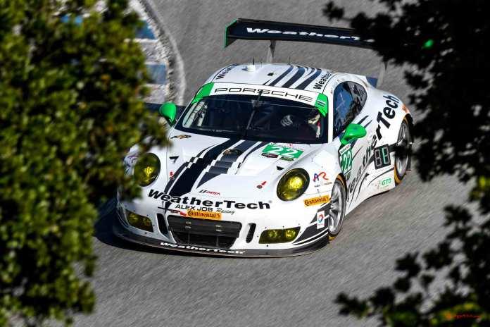 New 2016 Porsche 911 GT3 R wins first race: No. 22 GT3 R on Corkscrew between oaks at 2016 Laguna Seca. Credit: Porsche AG