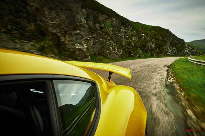 Top Ten CPO Tips for Buying a Certified Pre-Owned Porsche: Cayman GT4 and wing on Scotland road. Credit: Porsche AG
