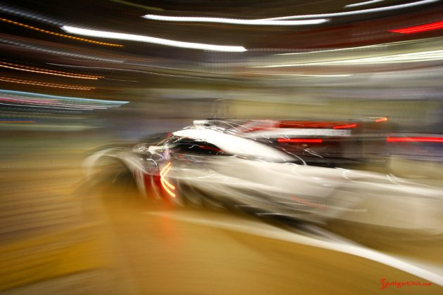 Porsche garners 18th overall win at 84th Le Mans 2016: No. 2 919 in night blur leaving pit. Credit: Porsche AG