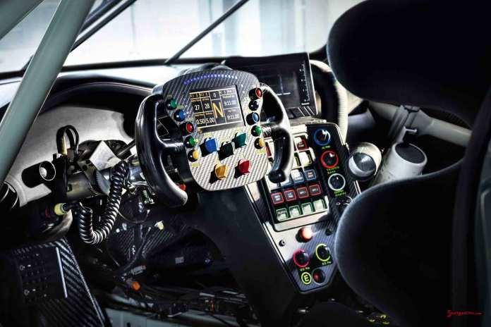 2017 Porsche GT-class 911 RSR: Rolex 24 Daytona debut - seen here is a view of the complex steering wheel of the 2017 911 RSR, looking in from the driver's door. Credit: Porsche AG