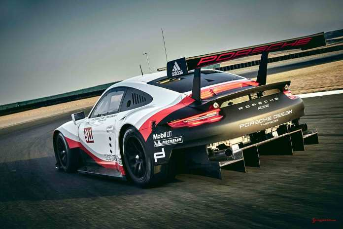 2017 Porsche GT-class 911 RSR: Rolex 24 Daytona debut - 2017 911 RSR seen here from its left-rear angle on track, displaying its ginormous rear diffuser. Credit: PAG