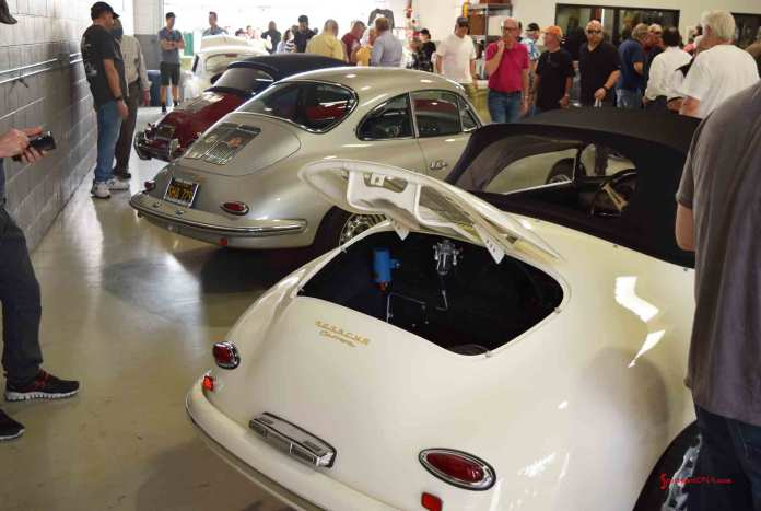 2017 Porsche L.A. Literature, Toy and Memorabilia Meet Weekend: Another angle of the Willhoit Auto Restoration main shop floor with the white 1957 GT Speedster Carrera in f.g. Early all-steel-bodied GT built at Werks. 547/1 GT engine on test stand, ready to install. Credit: StuttgartDNA