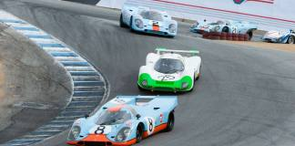 Rennsport Reunion V: We see here Porsche Gulf-liveried 917s and other Porsche racecars winding down Laguna Seca's famed Corkscrew. Credit: Porsche AG