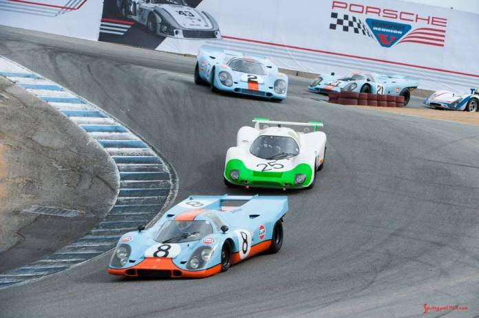 Porsche unveils official Rennsport Reunion VI poster - Rennsport Reunion V: We see here Porsche Gulf-liveried 917s and other Porsche racecars winding down Laguna Seca's famed Corkscrew at the 5th Reunion. Credit: Porsche AG