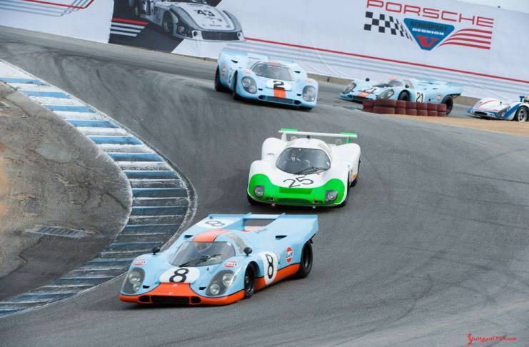 Rennsport Reunion V: We see here Porsche Gulf-liveried 917s and other Porsche racecars winding down Laguna Seca's famed Corkscrew. Credit: Porsche AG