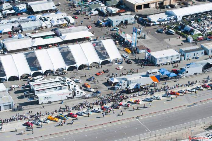 Porsche announces 2018 Rennsport Reunion VI: Pictured here at Porsche Rennsport Rennsport V is an aerial view of the Laguna Seca grandstand straight and paddock filled with parked racecars in diagonal formation and thongs of spectators. Credit: Porsche AG