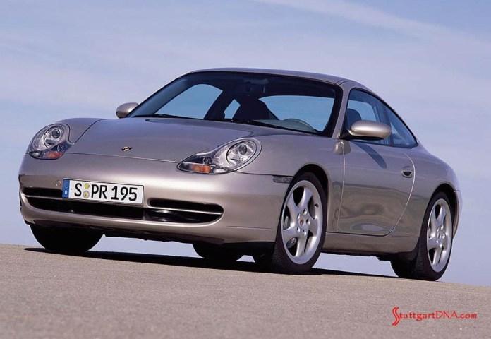 996-gen Porsche 911 Buyer Guide: Shown here is the all-new 996-gen Porsche 911 Carrera, a tan coupe. Credit: Porsche AG