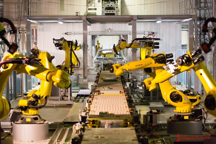 996-gen Porsche 911 Buyer Guide: Seen here on a Porsche assembly line are Kuka robots idle in body shop. Credit: Porsche AG