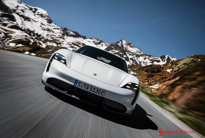Porsche Taycan first electric sports car world premiere: Seen here is a white Taycan Turbo S, canted front, at speed on a mountain road Credit: Porsche AG