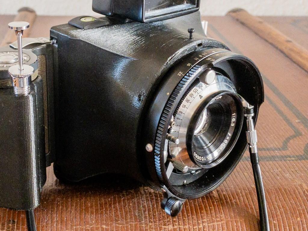Close-up of the Mamiya 65mm f/6.5 lens mounted on the Ligero camera