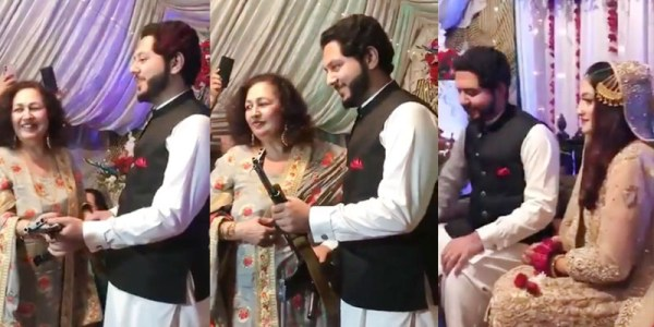 Mother-in-law Presents an AK-47 To Groom As Wedding Gift