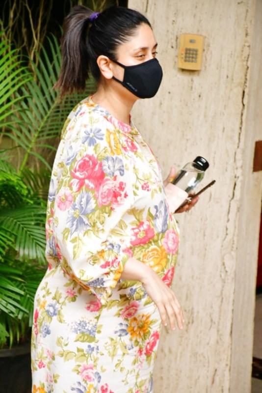 Pregnant Kareena Kapoor shows off baby bump in this midi