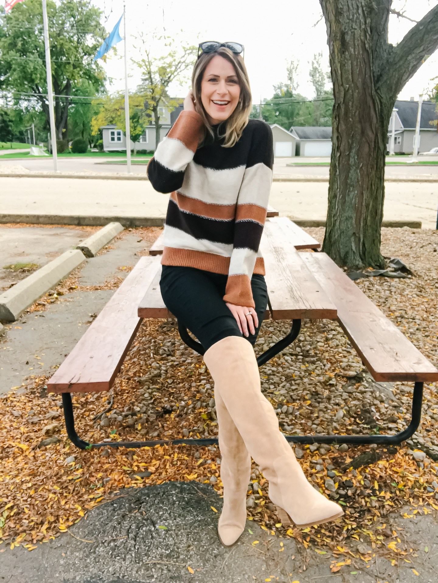A Cognac And Black Sweater With 2 Shoe Options
