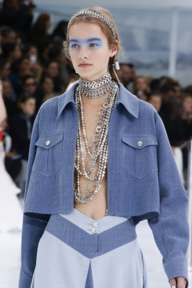 The cascade of necklaces + the open denim shirt