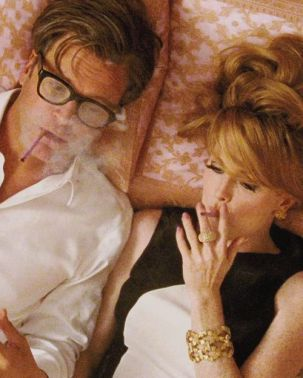 Colin Firth as George and Julianne Moore as Charlotte laying on bed with incredibly chic 60's looks, smoking pink cigarettes. A Single Man, Tom Ford (2009)